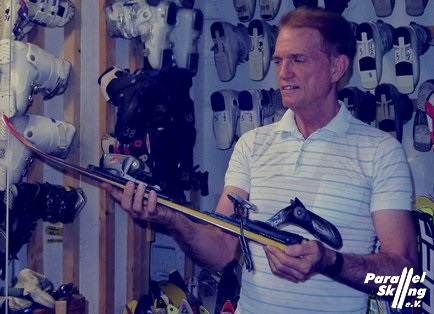 Ken Lawler showing first day short ski equipment room