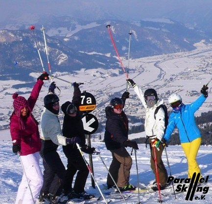 Happy Skiiers on top of the world